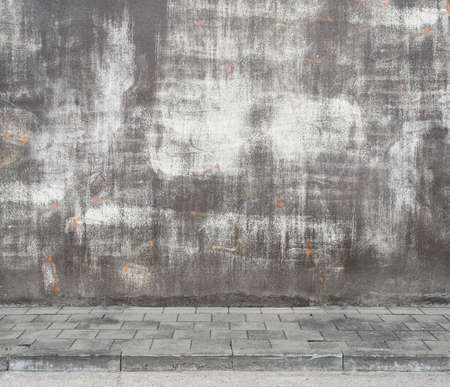 weathered: Urban background. Grunge obsolete street wall texture with deleted graffiti.