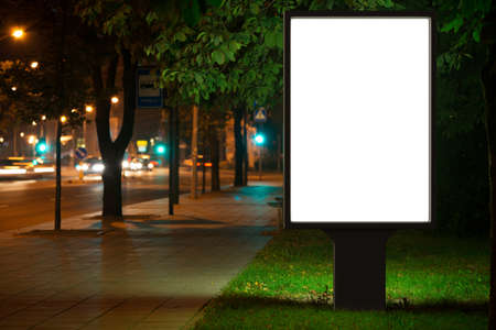 advertising board: Blank advertising billboard in the city at night.