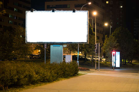 billboard advertising: Blank advertising billboard in the city at night.