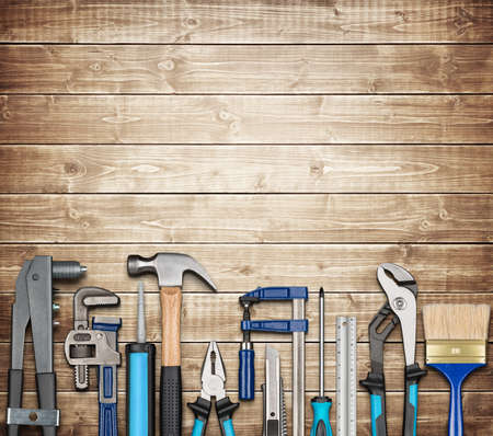 tools: Various carpentry, repairing, DIY tools on wooden background