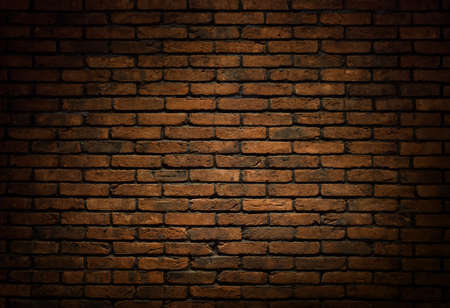 eroded: Dark brick wall background, texture