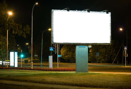 billboard: Blank advertising billboard in the city at night.