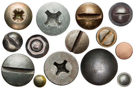 Screw heads, nuts, rivets isolated on white.