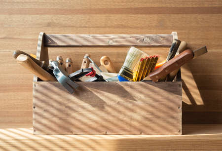 toolbox: Wooden toolbox with carpentry tools on the shelf