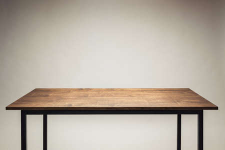 Wooden table against gray background.