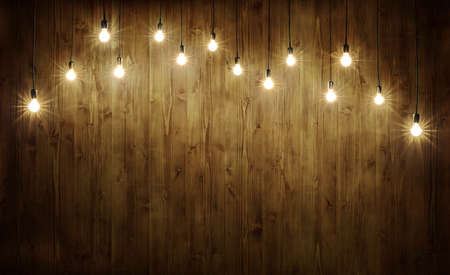 Light bulbs on dark wooden background Standard-Bild