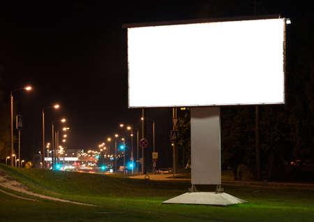 billboard background: Blank advertising billboard in the city at night.