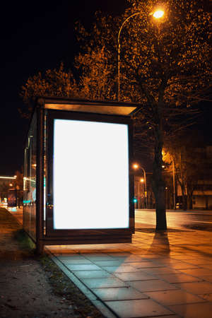 bus background: Blank bus stop advertising billboard in the city at night. Stock Photo