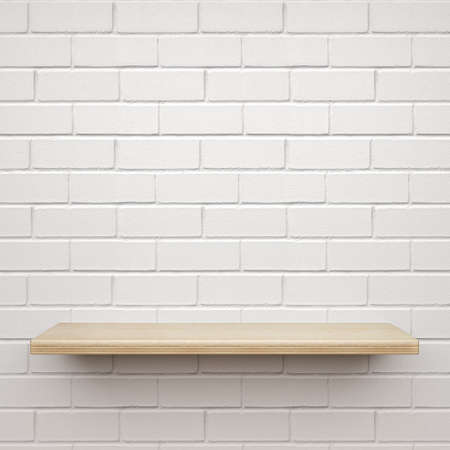 Empty wooden shelf on white brick wall