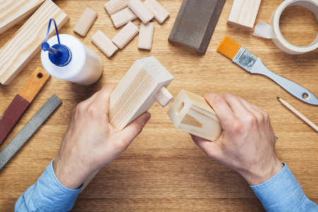 tenon: Woodworking workshop table top scene. Making of loose tenon joint. DIY concept. Stock Photo