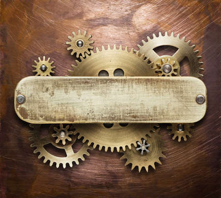 copper background: Clockwork mechanism collage on copper background made of metal gears, brass plate. Stock Photo