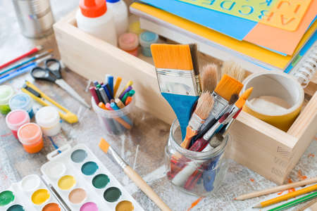 Paint brushes and crafting supplies on the table in a workshop. Stock Photo - 61093005