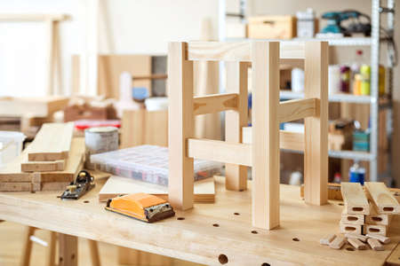 stool: Stool making in woodworking workshop. Stock Photo