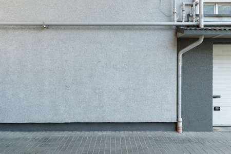 Urban background. Street wall and pavement.
