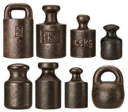 Old rusty iron scale weights isolated on white Stock Photo