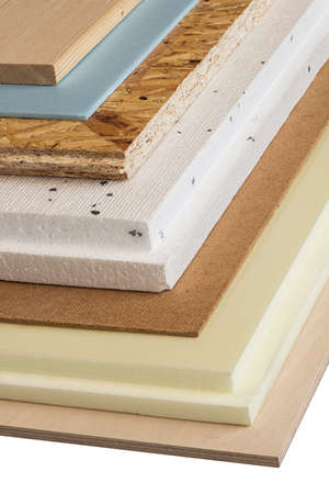 modernize: Stack of various construction supplies. Insulation foams and wood boards. Stock Photo