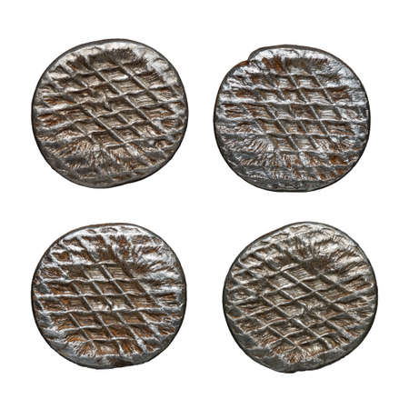 Old rusty nail heads, isolated on white. 版權商用圖片