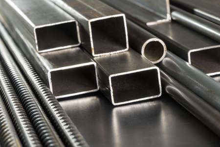 Metal pipes and rods. Steel materials, construction supplies.