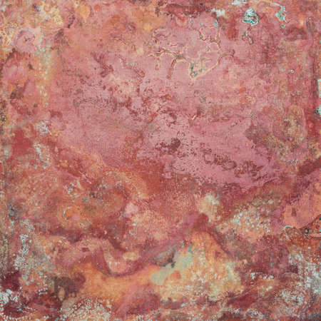 Aged red copper plate texture with green patina stains. Old worn metal background.
