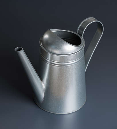Metal watering can on gray background photo