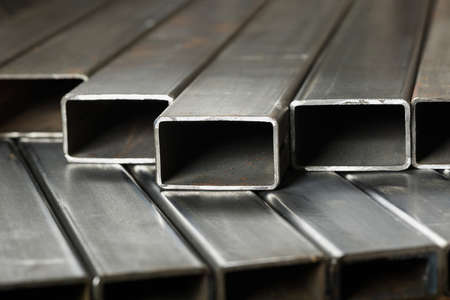 Rectangular metal pipes . Steel materials, construction supplies. Stock Photo