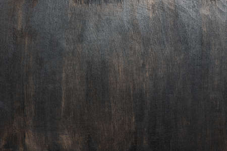 Wood texture, dark painted scratched plywood board background
