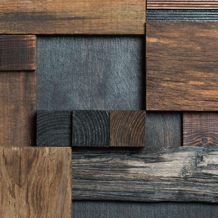 Abstract dark wood block collage background.