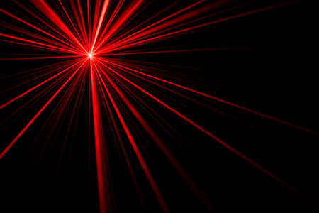 Red laser beam light effect on black background, photo.