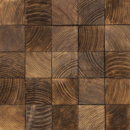 Brown end grain wood texture. Cross cut lumber blocks.