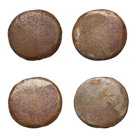 Old rusty nail heads, isolated on white. Stock Photo
