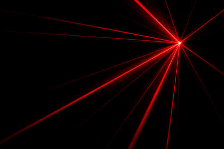 Red laser beams light effect on black background photo. Stock Photo
