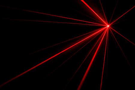 Red laser beams light effect on black background photo. 版權商用圖片 - 87938324