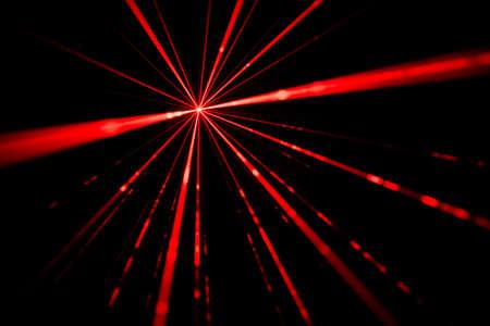 Red laser beams light effect on black background photo. 版權商用圖片