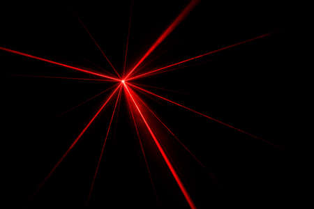 Red laser beam light effect on black background, photo.