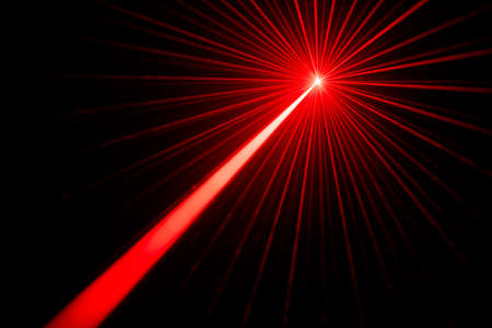 Red laser beams light effect on black background photo. Archivio Fotografico