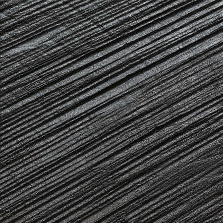 Dark painted wood texture. Rough lumber background with saw marks. Stock Photo