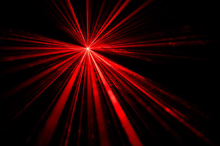 Red laser beam light effect on black background Stock Photo