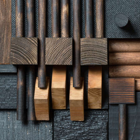 Abstract dark wood block collage background.