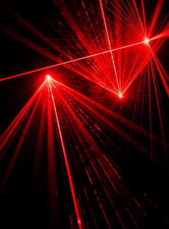 Red laser beam light effects on black background