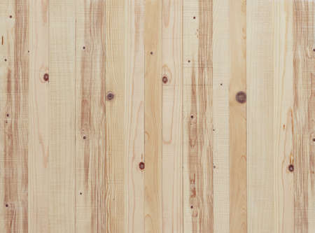 Light yellow wood background. Rough cut pine board texture. Stock Photo