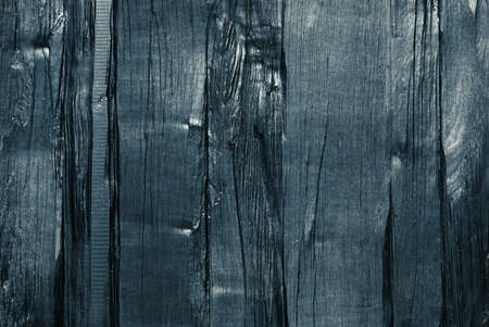 Dark blue tint wood texture. Painted rough lumber board background. Stock Photo