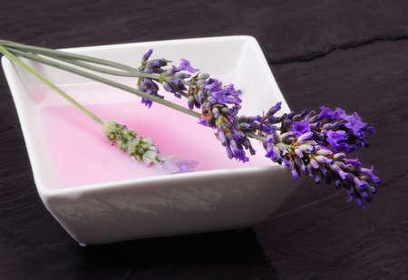 lavender bath foam with fresh flowers photo