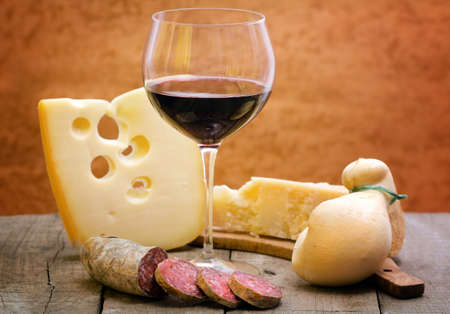 selection of cheese and salami with  red wine photo