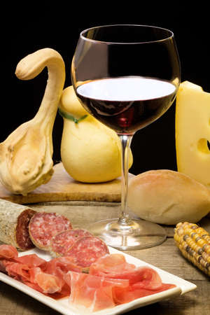 selection of cheese, salami, parma ham and red wine photo