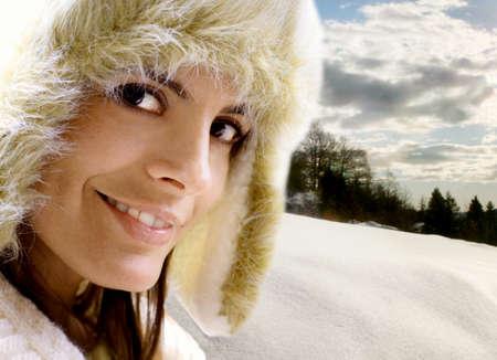 winter girl against snowy landcsape photo