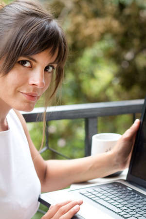 woman with laptop in a relaxing scene photo