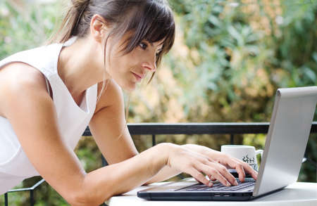internet search: brunette woman making shopping on line