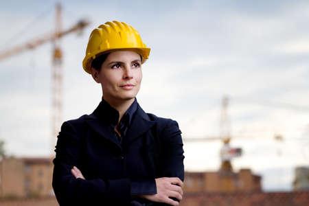 female engineer against building yard photo
