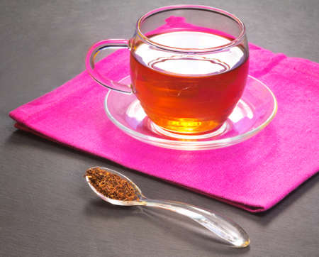 rooibos tea over pink napkin Stock Photo - 16878185