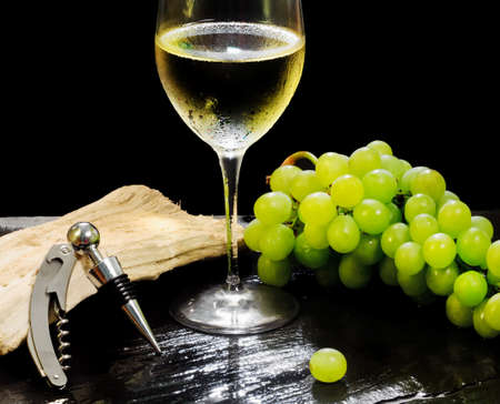 white wine glass: white wine glass with grapes bunch
